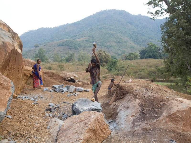 Labourers remove boulders from the landscape to make a road surface for the Vedanta plant in Lanjhigargh. In doing so they are causing irrepairable damage to the landscape. Stuart Freedman/ActionAid