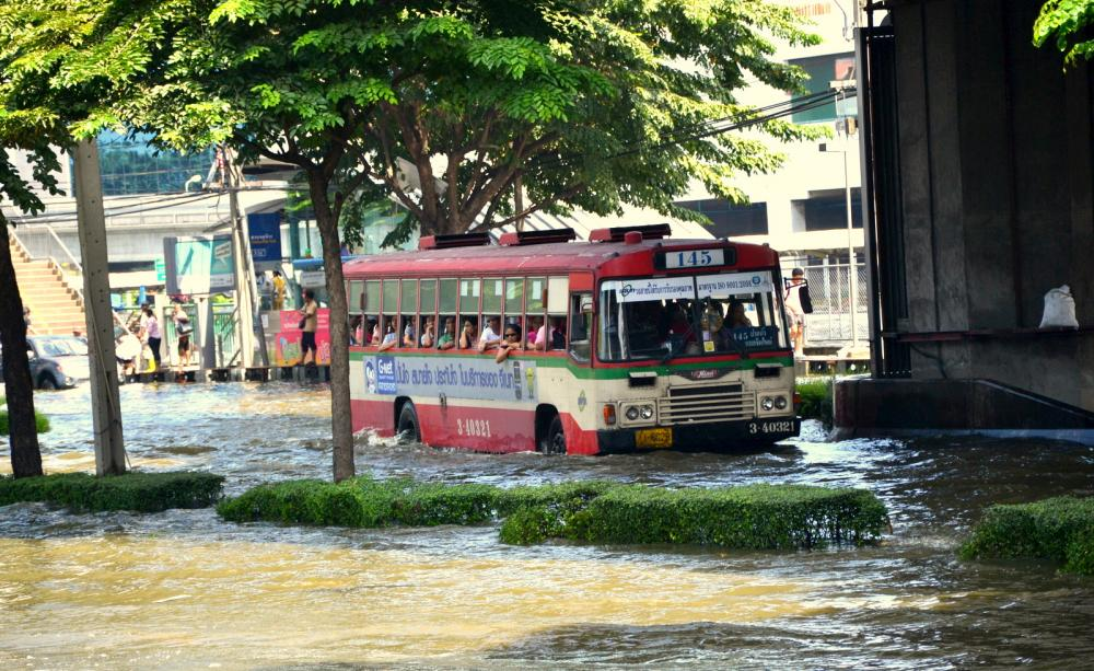 Bus driving through flood