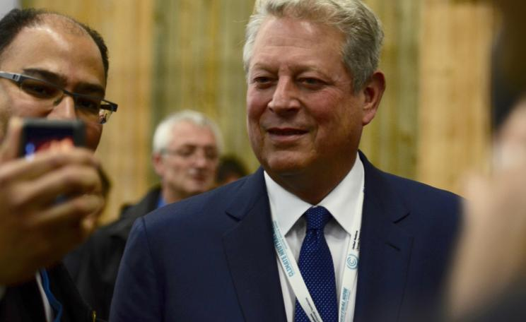 Man taking Al Gore's photograph