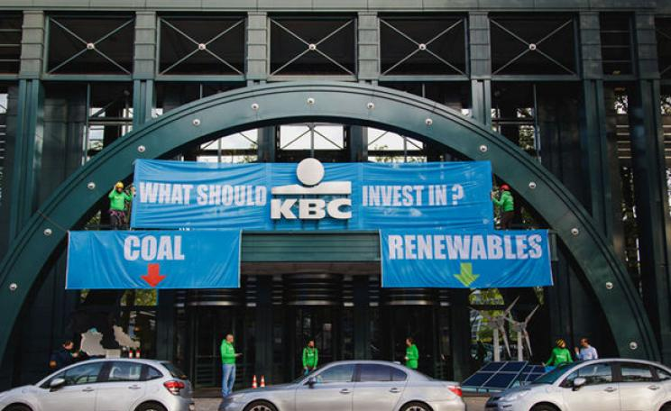 Greenpeace activists revamp the entry of the KBC bank building