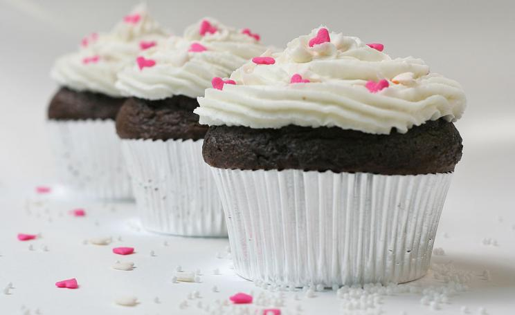 Chocolate cupcakes with sugar hearts and nonpareils