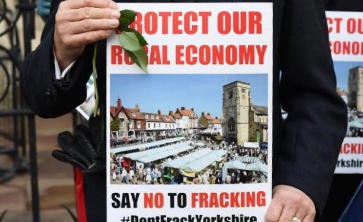 Sign reading 'protect our rural economy'
