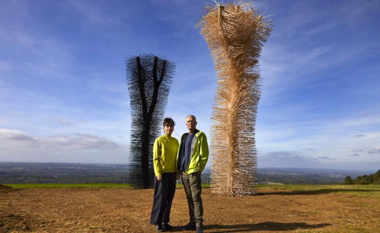 Artists Ackroyd and Harvey pictured in front of their artwork, Ash to Ash
