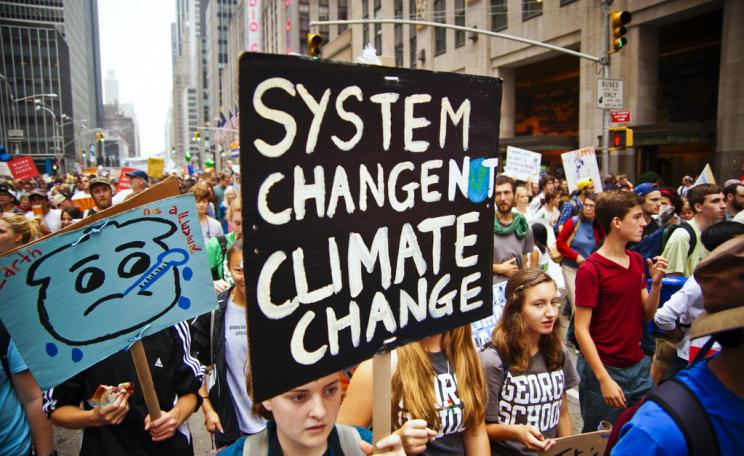 Placard reading 'system change not climate change'