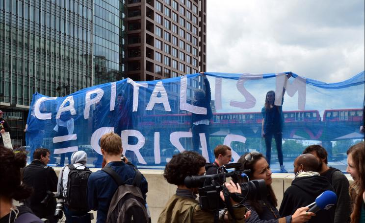 Capitalism = crisis banner