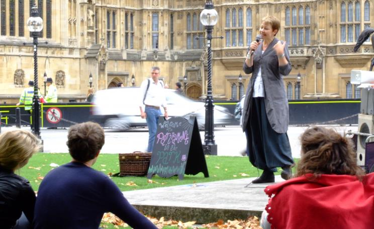 Caroline Lucas speaking outside of Parliament