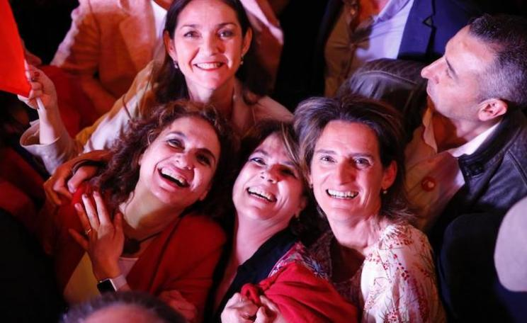Spain's finance minister Maria Jesus Montero, industry, commerce and tourism minister Reyes Maroto, justice minister Dolores Delgado García and minister for the ecological transition Teresa Ribera, celebrating Sunday's election win