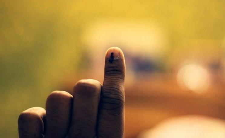 The ink-marked finger of an Indian voter