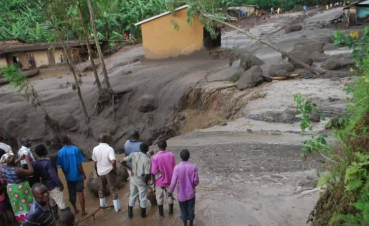 Villagers surveying damage from mudslides