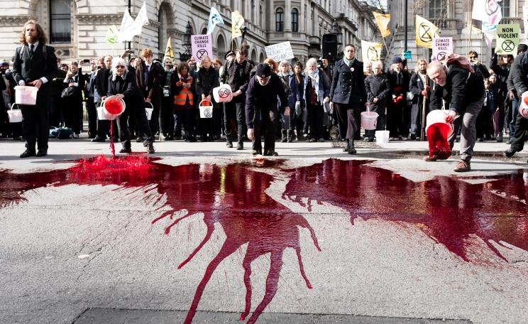 Protesters spill fake blood outside Downing Street