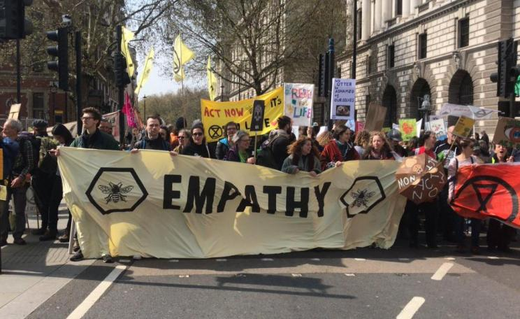 XR 'Empathy' banner and protesters