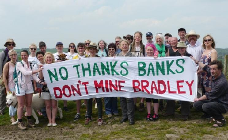 Protesters in countryside with banner saying 'No thanks Banks, don't mine Bradley'.