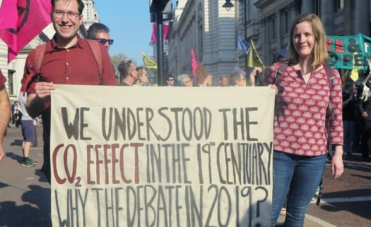 Scott Archer-Nicholls and Caroline Oswald carry a placard at a recent Extinction Rebellion demonstration in London