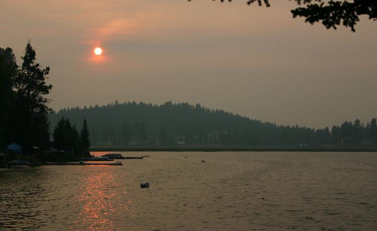 Sunset over Loon Lake, Washington. Atmospheric conditions created by forest fire about 1 mile from location photo was taken.