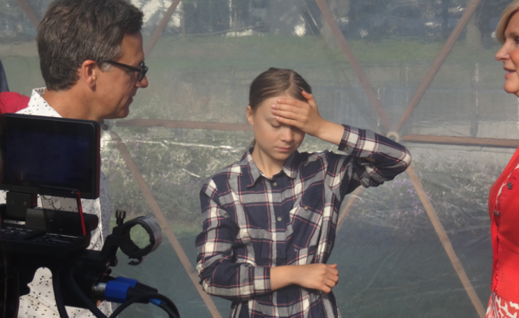 Greta Thunberg with artist Michael Pinsky inside the Pollution Pods at the UN Climate Summit,