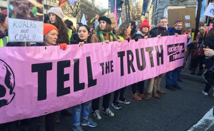"Members of XR hold up a ""Tell the Truth"" banner in London while protesting against the Australian government's response to the bushfires."
