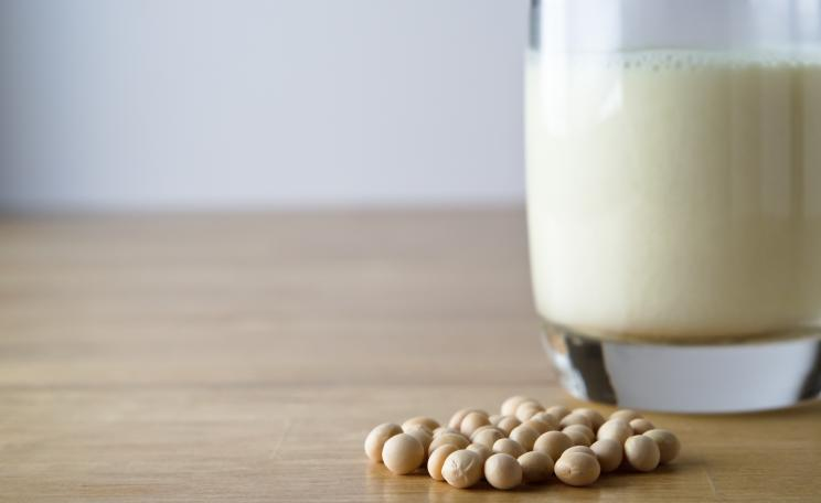 Glass of soya milk with soya beans