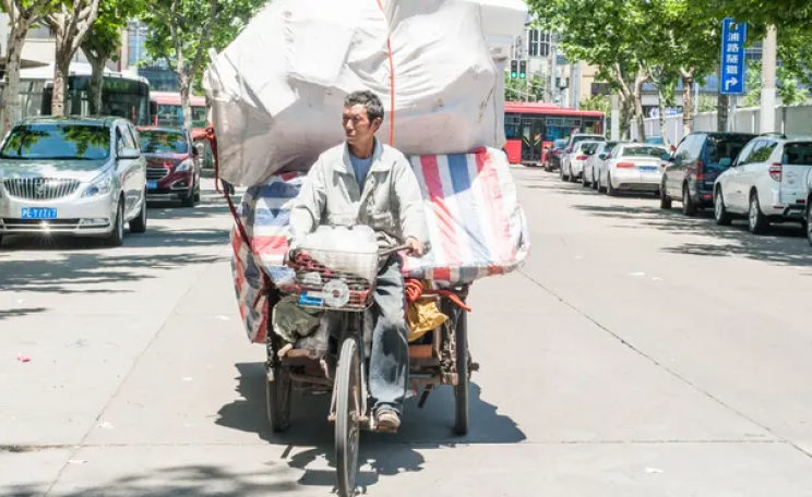 waste recycler on bike in China