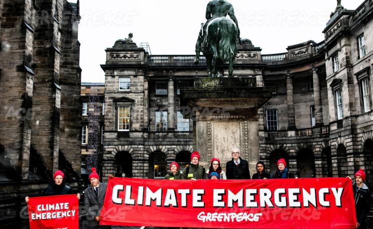 Greenpeace supporters outside Edinburgh's Court of Session