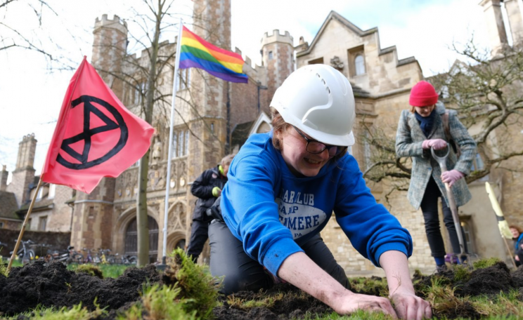 XR activist digging up lawn