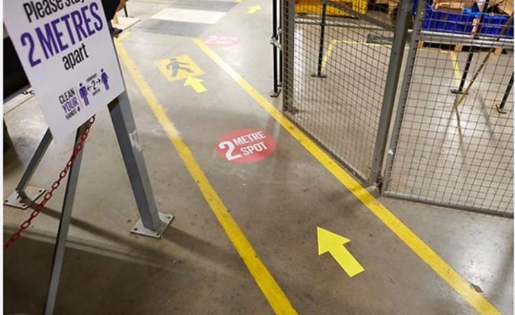 Markings on the floor in a warehouse will help workers with social distancing