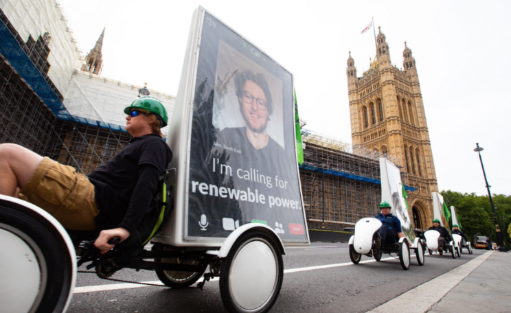 Keeping to COVID-19 social distancing rules, 7 bikes carrying ad screens with huge faces of people attending virtually cycled across Westminster Bridge and parked up near Parliament Square to bring the people to Parliament with their asks for MPs.