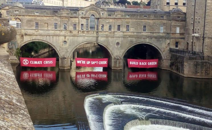 XR unfurls banners in Bath - the government is not heeding warnings on climate change, it says