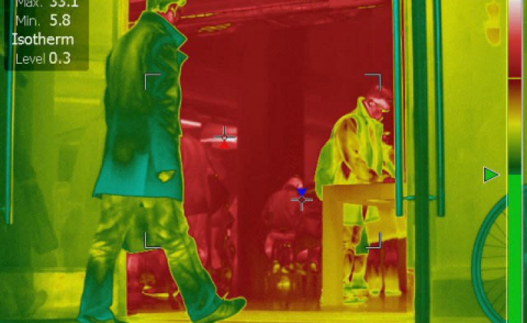 Infra-red image showing how open shop doors pour heat into our streets. Image: closethedoor.org.uk