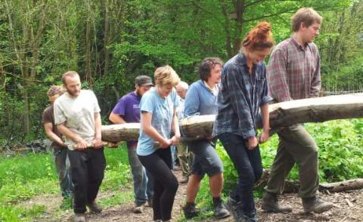 Hauling sweet chestnut roundwood up the steep include. Photo: Moulsecoomb Forest Garden.