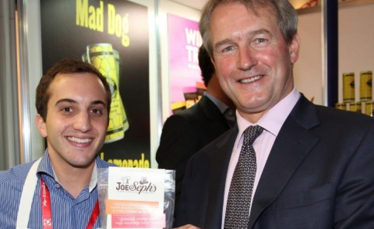 Owen Paterson MP with Joe & Sephs Gourmet Popcorn. The 'Mad Dog' sign refers to a brand of lemonade. Photo: UKTI via Flickr.
