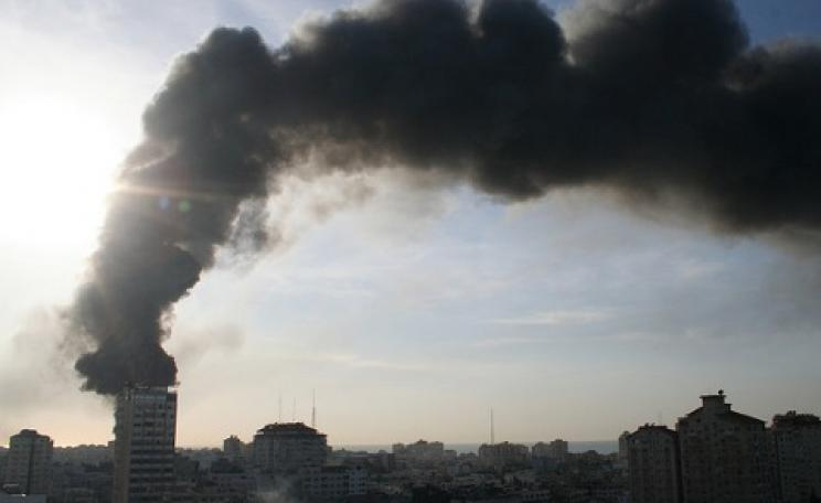 Black smoke billows from the UNWRA compound set ablaze by Israel in Operation Cast Lead, 15th January 2009. The compound was burned to the ground. Photo: Al Jazeera English via Flickr.
