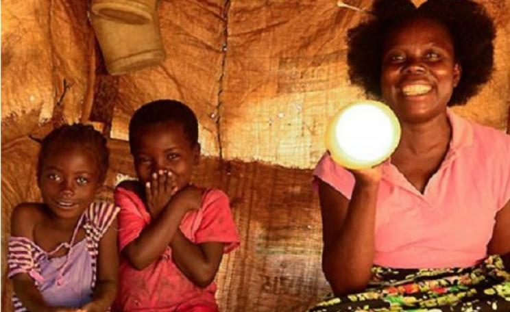 Happy family - pleased to enjoy solar lighting for the first time. Photo: SunneyMoney.