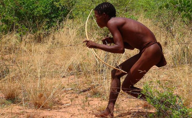 A San 'Bushman' hunter wıth bow and arrow. Photo: Charles Roffey via Flickr (CC BY-NC-SA 2.0).