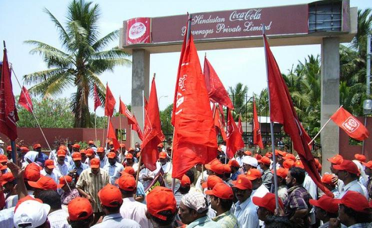Protest at Coca Cola's bottling plant at Plachmada, Kerala. The plant has since been closed for rampant pollution. Photo: kasuga sho via Flickr (CC BY-NC-SA).