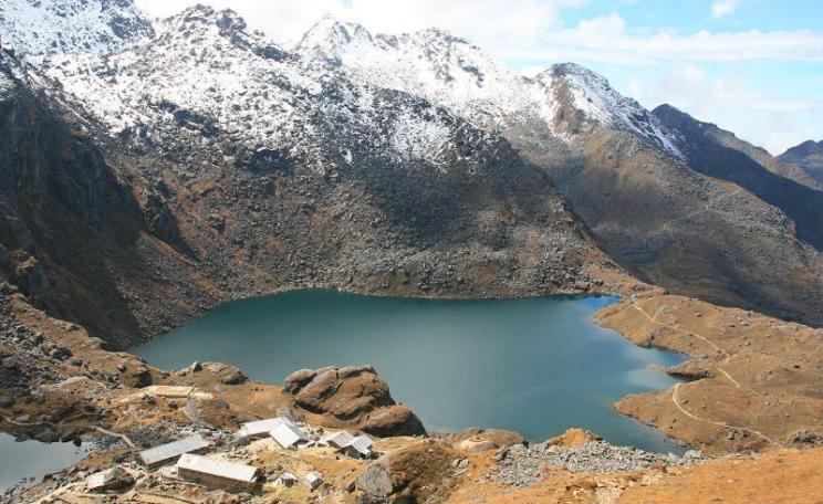 The sacred water of Gosainkunda Lake at the headwaters of the Trishuli River, soon to be changed forever by the construction fo a succession of high dams. Photo: Yosarian via Wikimedia Commons (CC BY).