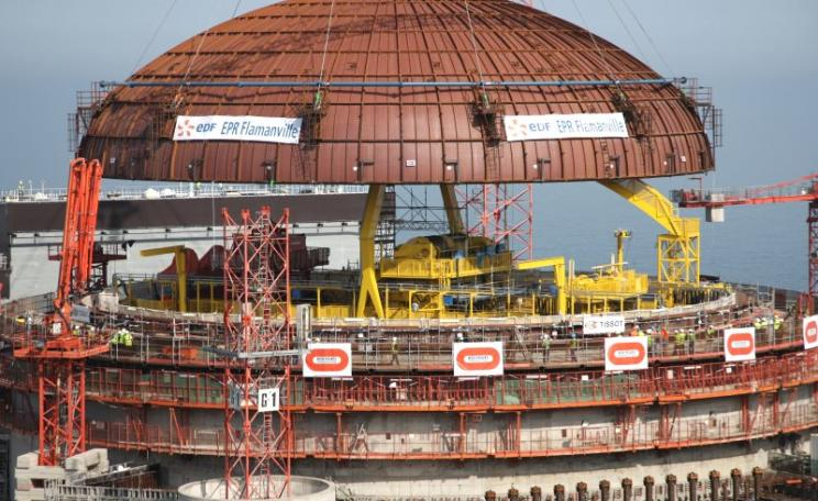 EDF puts in place the reactor dome on the Flamville 3 EPR reactor in July 2013. But sadly it failed to make sure the reactor vessel that sits at its heart was up to scratch first. And it's not - it has serious metallurgical flaws that could end up sinking