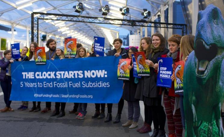 Pop-up protest at COP21 today at the Le Bourget Conference Centre: 'Five years to end fossil fuel subsidies!' Photo: stopfundingfossils via Flickr (CC BY-NC-SA).