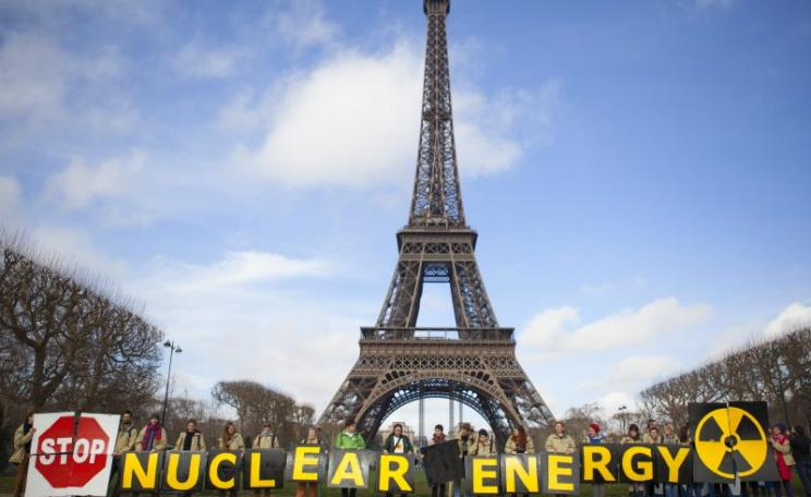 'Stop nuclear energy! - demonstration on the Champs de Mars, Paris, in front of the Eiffel Tower. Photo: GLOBAL 2000 via Flickr (CC BY-ND).
