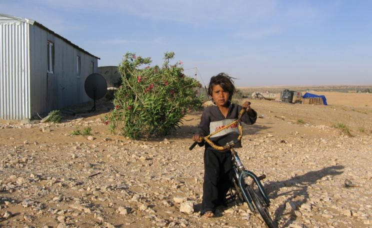 A child in one of the 'unrecognised' Bedouin villages of the Negev desert, Israel: an Israeli citizen, but one less equal than others. Photo: Physicians for Human Rights - Israel via Flickr (CC BY-SA).