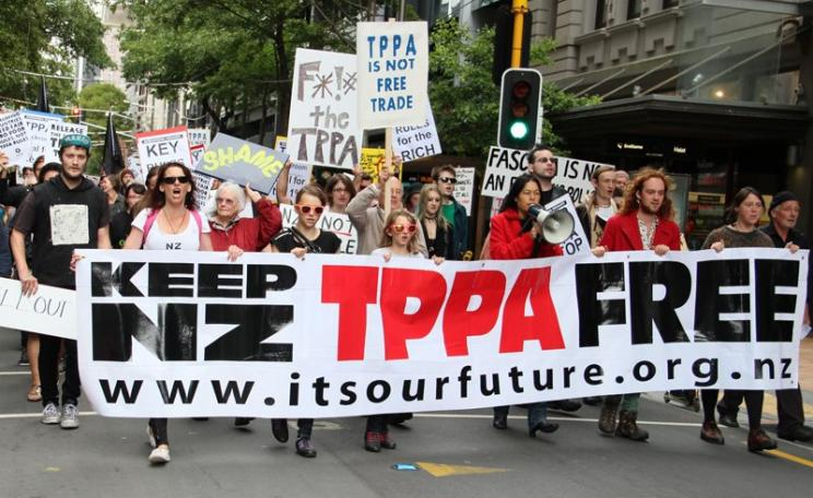 The TPP is none too popular in New Zealand, where trade ministers are signing it today, either. No TPPA! march in Wellington, NZ, 31st March 2014. Photo: Peg Hunter via Flickr (CC BY-NC).
