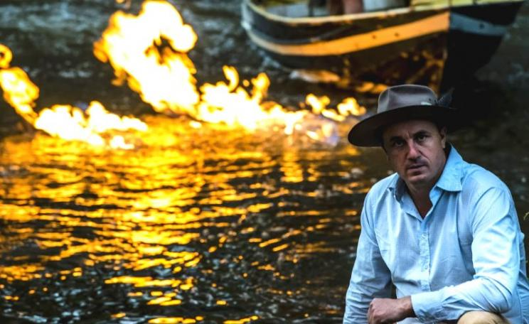 Greens MP Jeremy Buckingham by the burning Condamine River in Queensland, Australia. Photo: Jeremy Buckingham.