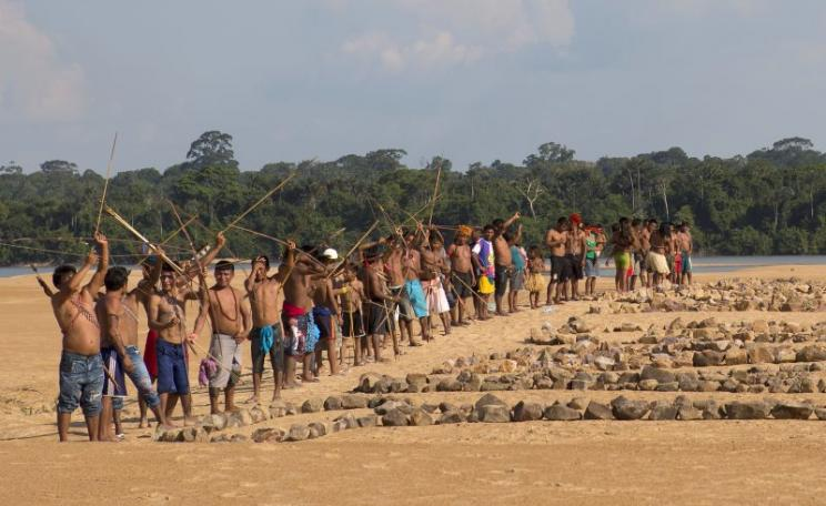 Greenpeace activists and Munduruku Indians protest on a sandy beach on the banks of the Tapajos river, near Itaituba, Pará, where the government plans to build the first of a series of five dams. Photo: Greenpeace Brazil via Flickr (CC BY).