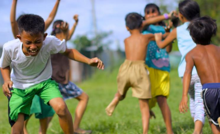 How will the promoters of GMO golden rice ensure that malnourished children receive it in the first place? Will they also ensure they get the dietary fat they need to actually assimilate the carotene once they have eaten it? Photo of children playing in M