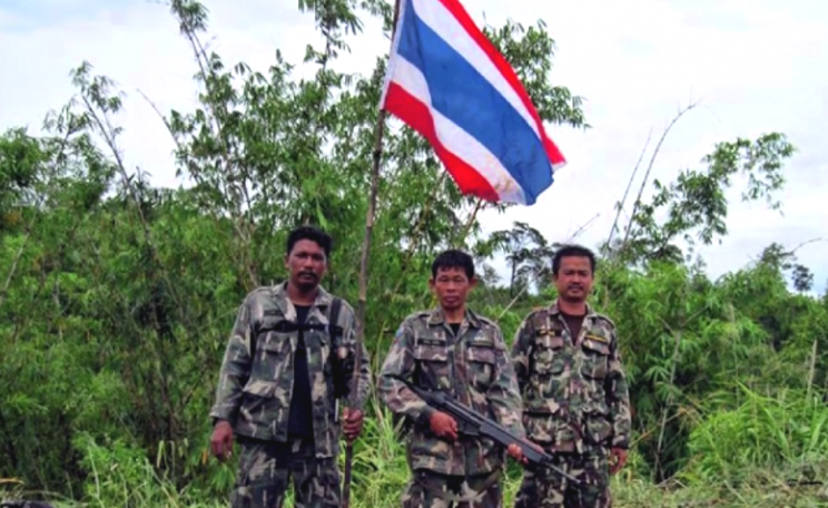 Soldiers came with the park officers. They planted a Thai flag and told the Karen to leave the village at once, or be shot. Photo: via CW.