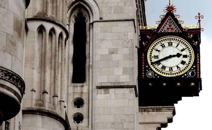 The wheels of justice may grind exceedingly slow, but also exceedingly fine. Clock at the Royal Courts of Justice on the Strand, London. Photo: Andy Sedg via Flickr (CC BY-NC-ND).