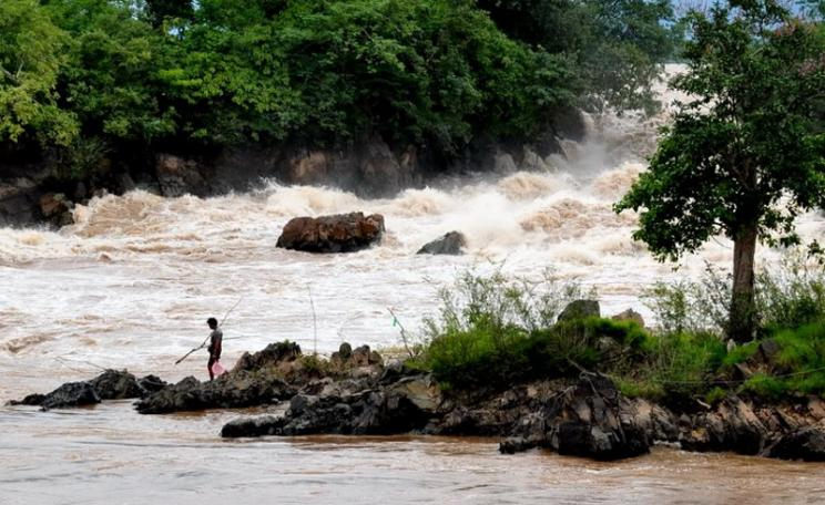 A fisher going to set his fishing gear at rapids at Don Sahong on the Mekong River. Photo: International Rivers via Flickr (CC BY-NC-SA).