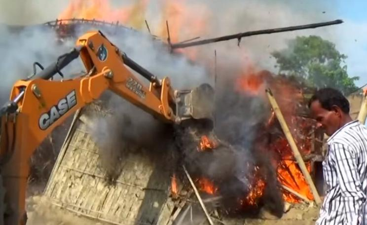 A village being destroyed with fire, bulldozers and elephants as the Kaziranga Reserve doubles in size into local farmland and settlements. Photo: still from video by BBC Newsnight.