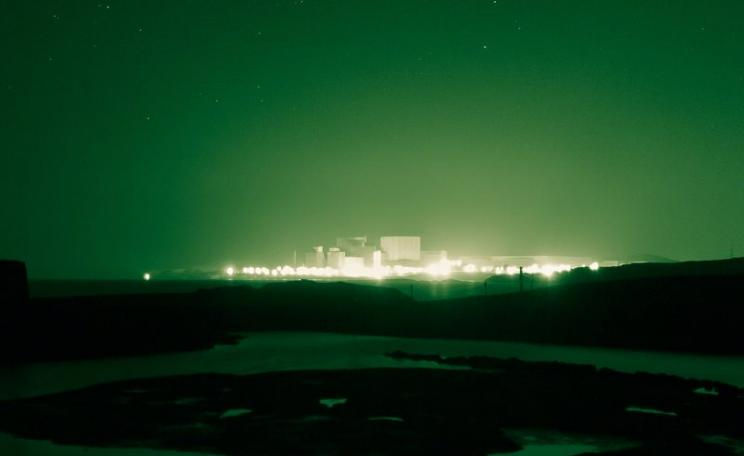 False promise ... Wylfa 2 nuclear power station glowing in the dark on Anglesey, Wales. Photo: Adrian Kingsley-Hughes via Flickr (CC BY-NC-ND).