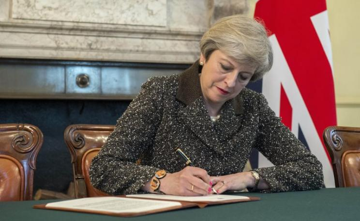Prime Minister Theresa May signed her Article 50 setting out the UK's intention to withdraw from the European Union, 28th March 2017. Photo: Jay Allen / Number 10 via Flickr (CC BY-NC-ND).