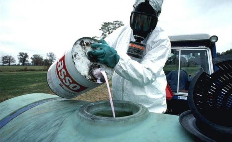 Monsanto Lasso herbicide is prepared to be sprayed on food crops.